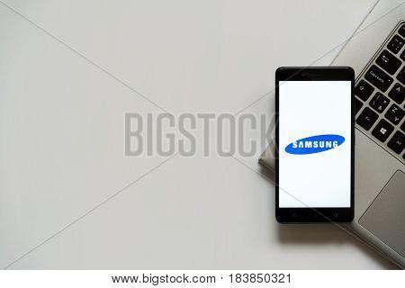Bratislava, Slovakia, April 28, 2017: Samsung logo on smartphone screen placed on laptop keyboard. Empty place to write information.