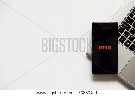 Bratislava, Slovakia, April 28, 2017: Netflix logo on smartphone screen placed on laptop keyboard. Empty place to write information.