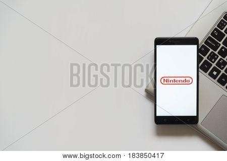 Bratislava, Slovakia, April 28, 2017: Nintendo logo on smartphone screen placed on laptop keyboard. Empty place to write information.