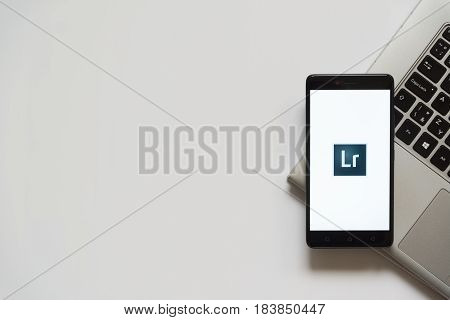 Bratislava, Slovakia, April 28, 2017: Adobe photoshop lightroom logo on smartphone screen placed on laptop keyboard. Empty place to write information.