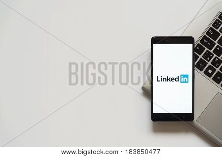 Bratislava, Slovakia, April 28, 2017: Linked in logo on smartphone screen placed on laptop keyboard. Empty place to write information.