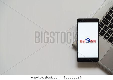 Bratislava, Slovakia, April 28, 2017: Baidu logo on smartphone screen placed on laptop keyboard. Empty place to write information.