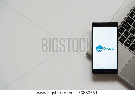Bratislava, Slovakia, April 28, 2017: Drupal logo on smartphone screen placed on laptop keyboard. Empty place to write information.