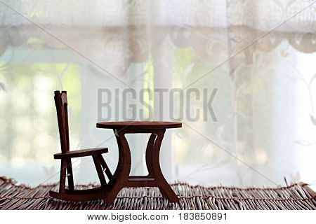Chair table set wooden decoration on blur window background