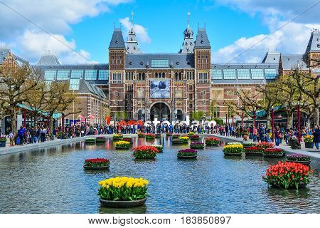 Amsterdam, Netherlands - Circa April 2017: The Rijksmuseum on Museumplein, I Amsterdam sign with tourists in Amsterdam.