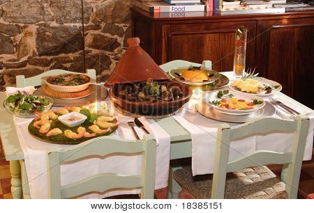 table with food in a restaurant poster