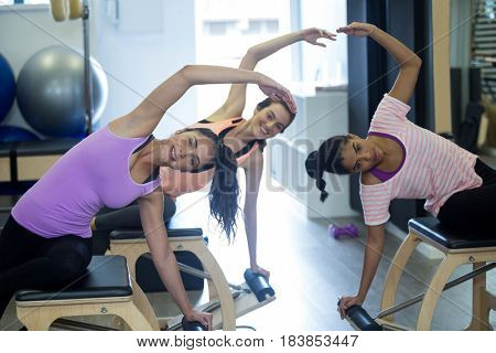 Group of women exercising on wunda chair in gym