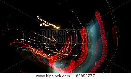Abstract Night lights illuminate the streets ,