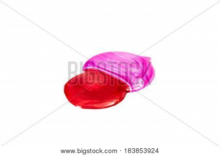 Blot of red and pink nail polish isolated on the white background