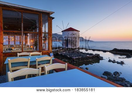 AGIA MARINA, GREECE - MARCH 25, 2017: Restaurant at the seafront of Agia Marina village on Leros island in Greece early in the morning on March 25, 2017.