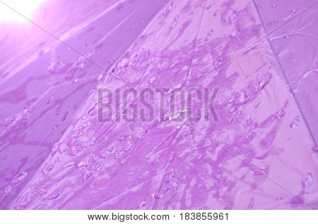 ice crystal and drop of water on purple umbrella