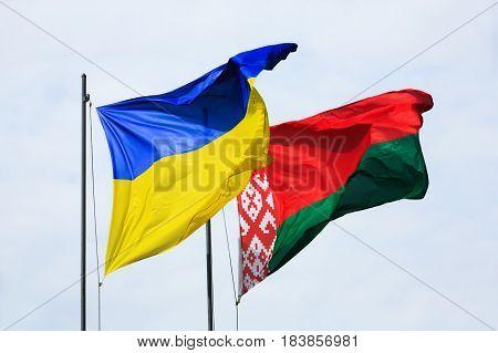 Waving Flags Of Ukraine And Belarus
