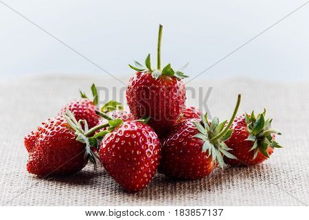 red close up strawberries with selective focus on a strawberry with many strawberries