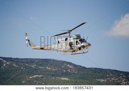 Helicopter bell uh 1, Exhaust gases mountain hill background