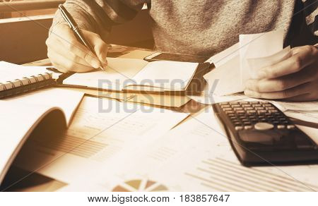 Businessman Calculate Finance With Holding Expense Bill.