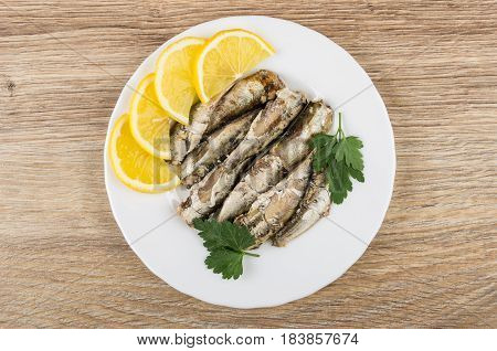 Plate With Sparts In Oil, Lemon And Parsley On Table