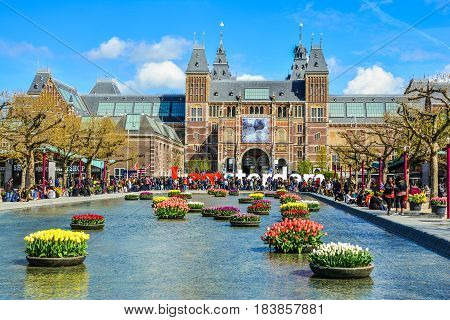 Amsterdam, Netherlands - Circa April, 2016: The Rijksmuseum on Museumplein, I Amsterdam sign with tourists in Amsterdam.