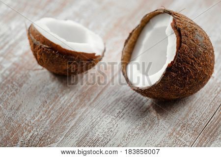 coconut isolated on a wooden background