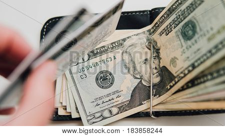 Top View Dollars And Cards In The Wallet. Close-up Of Dollars In Clip And Credit Card E-commerce. Ea