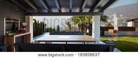 Porch of modern villa overlooking the garden