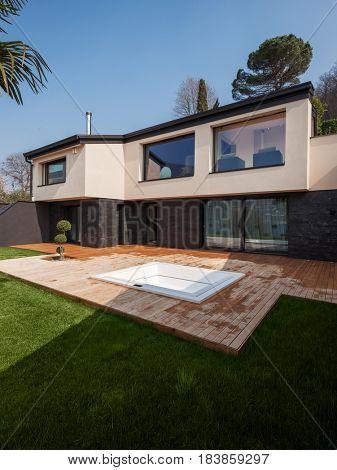 Exterior of a modern villa, veranda with pool