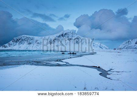 The snowy Skagsanden beach of the Lofoten Islands in evening