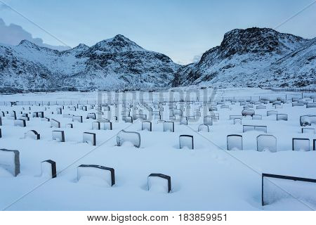 The old cemetery of Flakstad town in the Lofoten Islands in winter