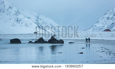 The traveling photographers on the Skagsanden beach in the Lofoten Islands