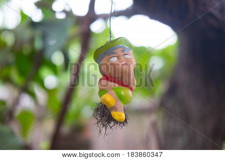 Earthernware child doll used for garden decoration.