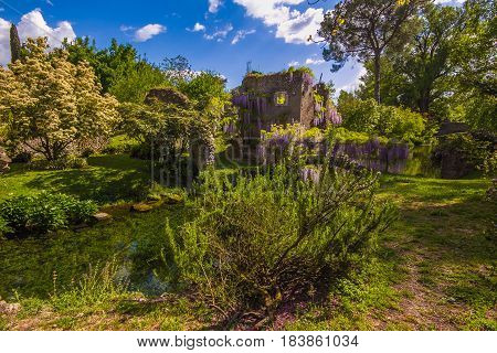 Enchanted spring landscape with little river, Italy