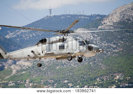 Black hawk helicopter rescue team,approach landing exhaust gas with aviation antennas on mountain background