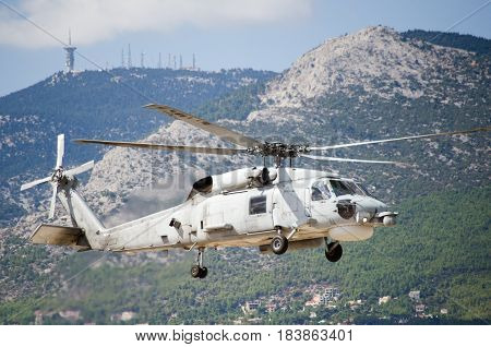 Black hawk helicopter rescue team.Approach landing exhaust gas with aviation antennas on mountain background
