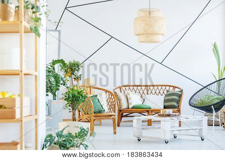 Living room with rattan sofa table and chair