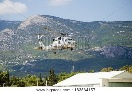 Black hawk helicopter rescue team,exhaust gas approach landing mountain background