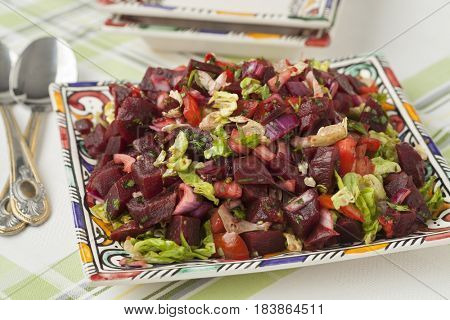 Modern designed dish with Moroccan beet salad close up