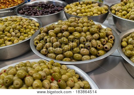 Bowls with different types of olives on the market
