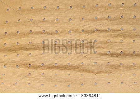 Medical objects health problems concept. Closeup of heating pad plaster bandage texture background