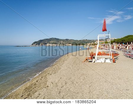 Lifeguard On The Beach Looking Bathers