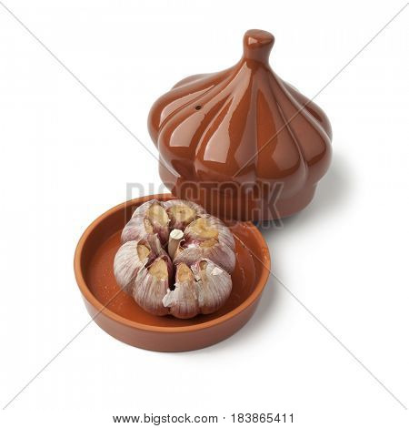 Roasted garlic in a ceramic bowl on white background