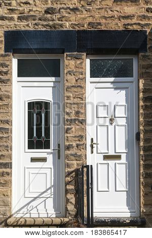 White Front Door of a Brick English Town House