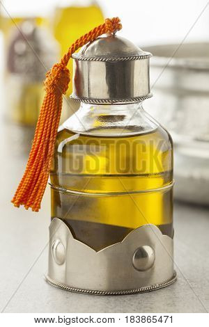 Moroccan bottle with organic cosmetic oil in the hammam