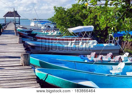 Boats lined up along a pier in Punta Allen near Tulum Mexico