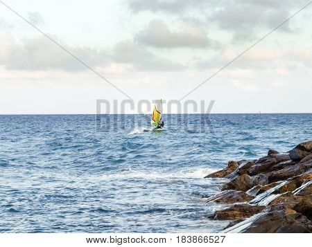 Oneglia Italy - June 14 2015: Windsurfing in the evening light