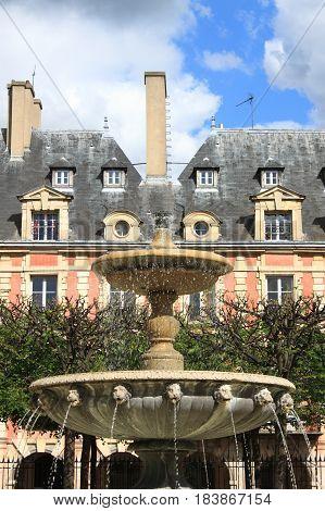 Fountain in Place des Vosges. Paris, France