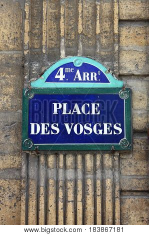 Place des Vosges street sign in Paris, France
