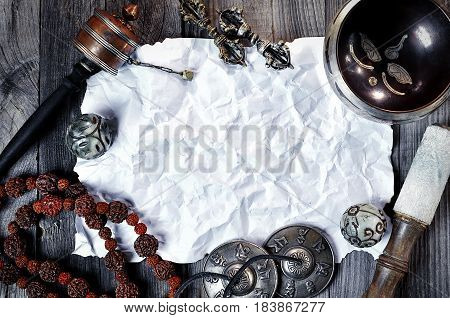 religion ethnic objects for meditation and relaxation: singing bowl strike plates drums beads and two balls mock up