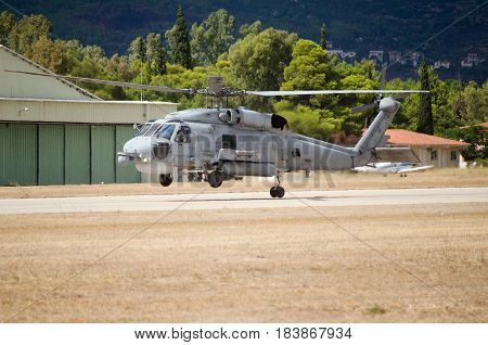 Black hawk helicopter rescue team, landing on airfield one back wheel touches the ground