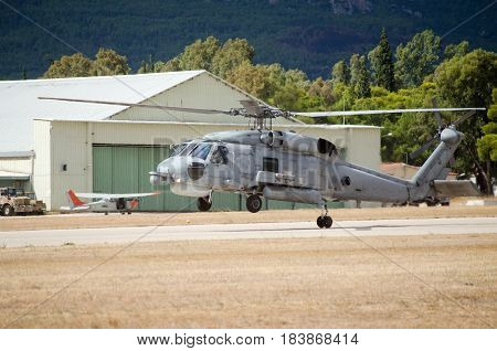 Black hawk helicopter rescue team landing on airfield one back wheel touches the ground