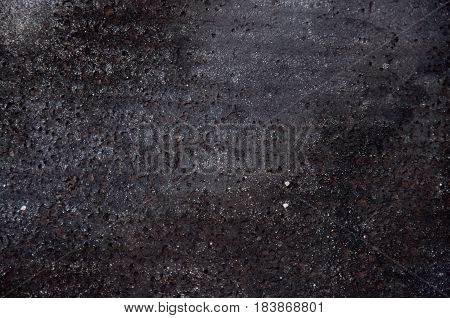 Detail of black resin waterproof ruberoid material with pattern. Texture background