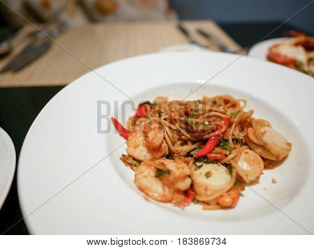 Spaghetti Pad Ki-Mao or stir fried chili seafood spaghetti in Thai style.